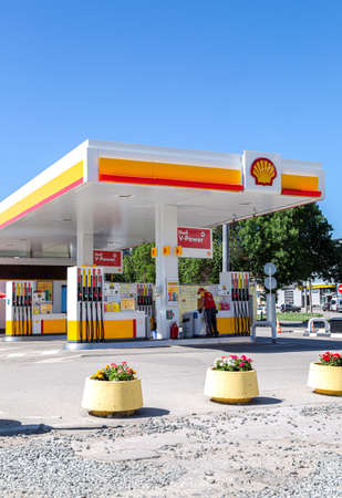 Samara, Russia - June 18, 2021: Shell gas station in sunny day. Shell V-power petrol station. Royal Dutch Shell is an Anglo-Dutch multinational oil and gas company