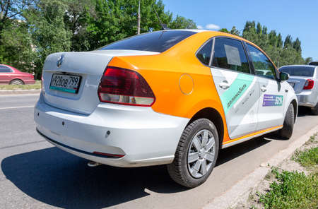 Samara, Russia - June 18, 2021: Car sharing Delimobil car parked in the city street. Rent a car of various brands. Carsharing service vehicle
