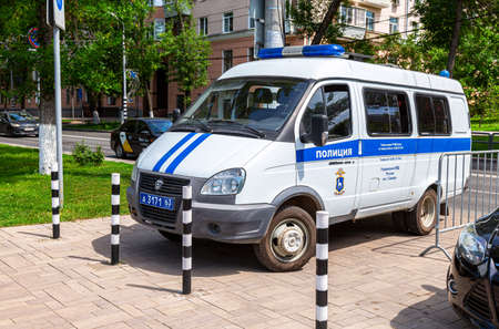 Samara, Russia - June 14, 2021: Police van parked on the city street in summer day