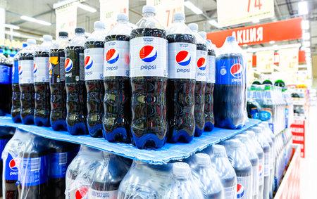 Samara, Russia - June 19, 2021: Plastic bottles of Pepsi Cola beverages in a store