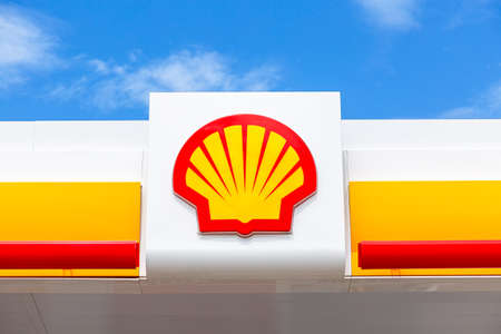 Samara, Russia - July 2, 2021: Shell gas station signboard against the blue sky. Shell V-power fuel station