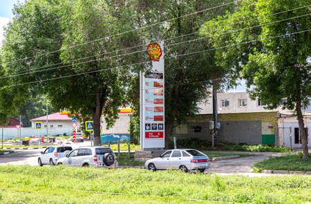 Samara, Russia - July 2, 2021: Guide sign, indicated the price of the fuel on the Shell gas station. Prices on the Shell fuel station