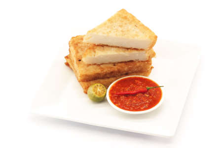 Fried Radish Patties - Traditional Asian Snacks Stock Photo - 8414838