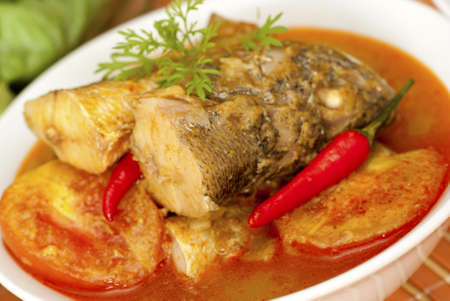 pesce cotto: Curry indiano di pesce Archivio Fotografico