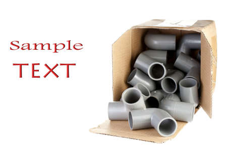 fittings: Opened Box of PVC Elbow Fittings