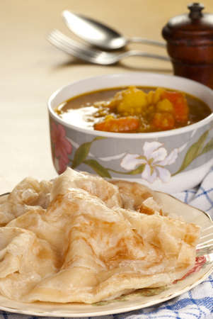 Roti Canai with Lentil Curry Stock Photo