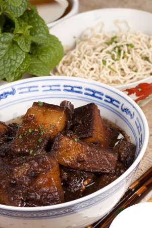 red braised: Braised Pork Belly Slices Cooked in Dark Soy Sauce Stock Photo