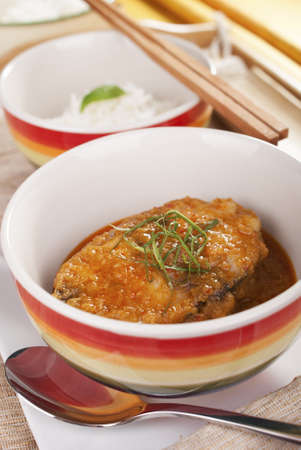 Thai Spicy Fish Steak Topped with Sawtooth Coriander photo