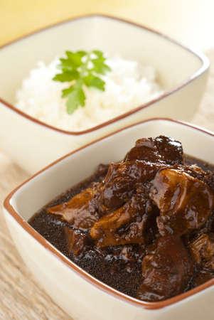 braised: Slow Braised Pig Trotters in Dark soy Sauce