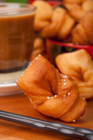 Chinese Fried Crullers quaintly called  boy-meets-girl in Cantonese - Asian Popular Fried Breads. Unsharpened file Stock Photo - 15860406