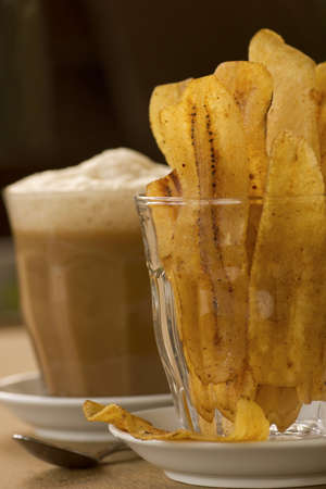 teh: Banana Chips with Teh Tarik Stock Photo