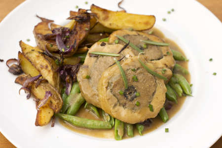 capon: Stuffed Chicken w Lyonnaise Potatoes Non sharpen file Stock Photo
