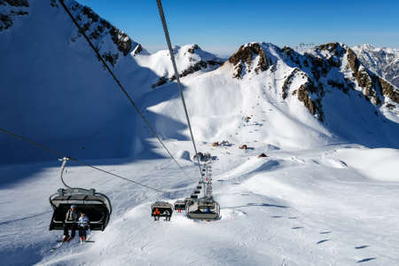 Sochi, Russia - January 20, 2013: Due to the unique microclimate, Aibga cirque ski slopes and chair lifts in Krasnaya Polyana can host ski and snowboard riders right until June Editorial