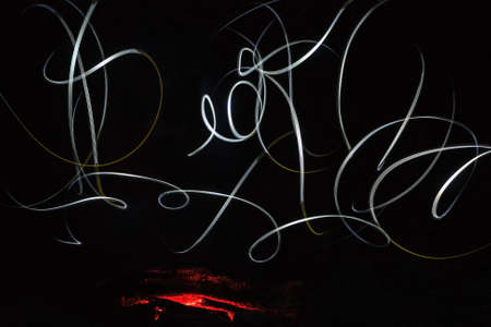 light painting: Abstract light painting background featuring campfire