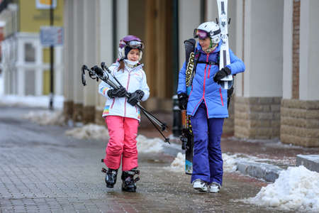 Sochi, Russia - January 9, 2015: Ski slopes in Gorky Gorod winter resort can be hosting skiers and snowboard riders during 6 months a year. Mother and daughter went out for a ski ride Editorial