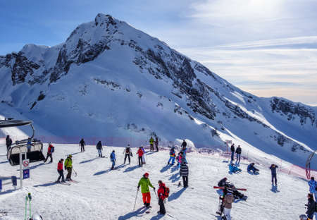 Sochi, Russia - February 7, 2014: Snowy ski slopes in Sochi mountain ski resorts can be hosting ski and snowboard riders for 6 months a year