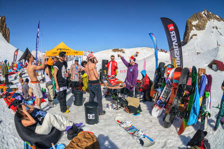Sochi, Russia - March 25, 2014: Quiksilver NewStar Camp is winter mountain sports and entertainment hangout for skiers and snowboarders. Many people chill out relaxing apres ski on snow on sunny day Editorial