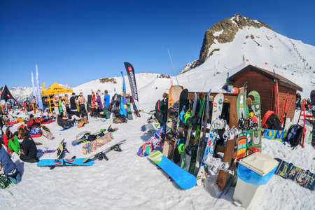 Sochi, Russia - March 25, 2014: Quiksilver NewStar Camp is winter mountain sports and entertainment hangout for skiers and snowboarders. Many people chill out relaxing apres ski on snow on sunny day