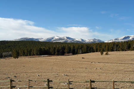 mountain range with cattle fence