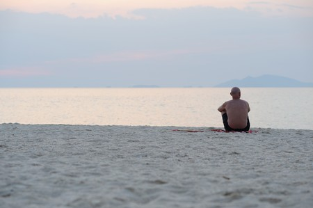 lonely person: Lonely old man on the beach