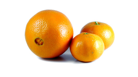 One orange two mandarins Stock Photo