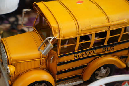Close up miniature metal toy yellow school bus