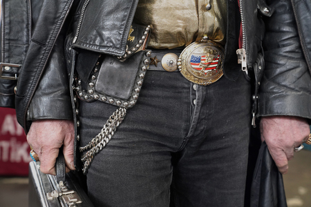 Modern cowboy with leather jacket and leather belt with buckle in the manner of american flag Stock Photo