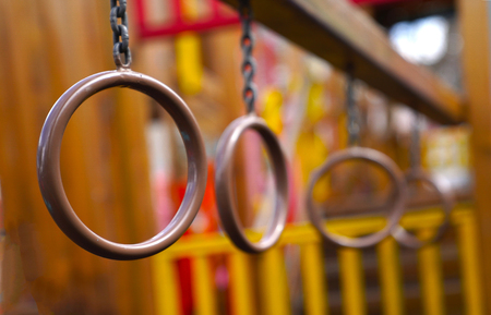 Iron ring chain for exercise climbing on blurred children playground Stock Photo