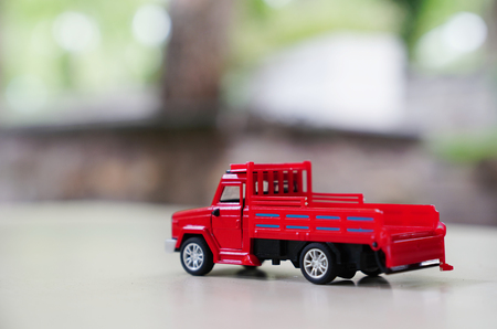 Red toy car truck blurred background