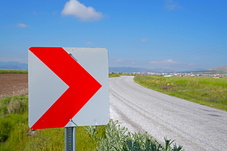 Road signs warning drivers about ahead dangerous curve Stok Fotoğraf