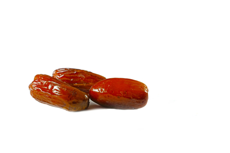 Three dried date fruit on isolated white background Stok Fotoğraf