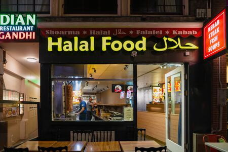 Amsterdam/Holland - October 06 2019: Halal food store with doner kebab in the evening