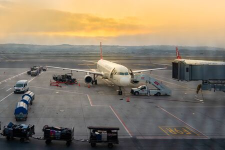 Istanbul  Turkey - October 03 2019:  Airport ground services, operations and taxi in Istanbul Airport in sunrise