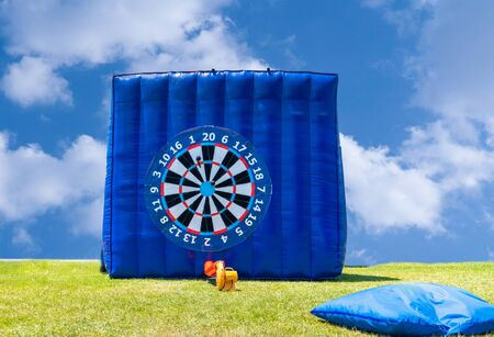 Giant inflatable foot dart board in outside/outdoor.