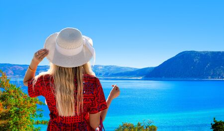 The girl with white hat looking Lake Salda from hill, Burdur, Turkey