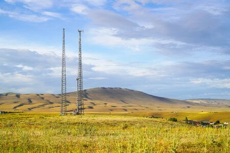 2 mobile phone base stations with cloudy sky background in the country in Turkey. Competition for mobile phone users. Banque d'images