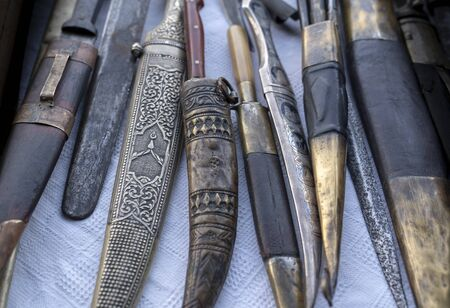 Antique roman, medieval, ottoman stile knifes, daggers and swords in a collection.