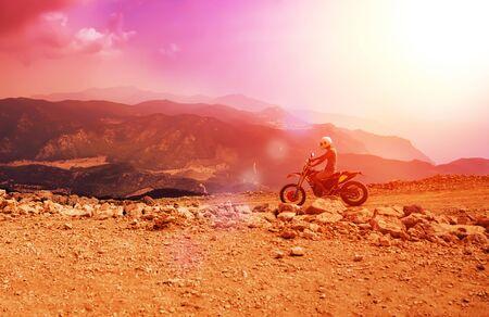 Mountain motor biker riding on dusty road on Babadag, Mugla/Turkey Reklamní fotografie