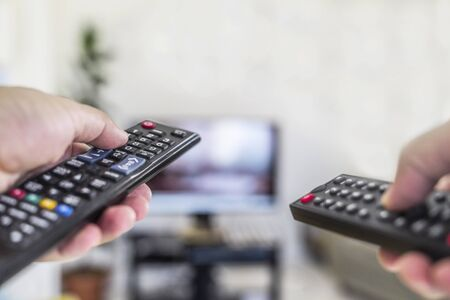 Watching tv and using two remote control