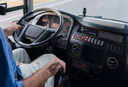 Bus's dashboard with the driver.