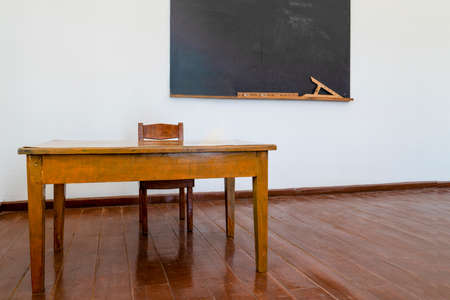 The materials for math lesson stand on the chalkboard in a classroom. Stockfoto