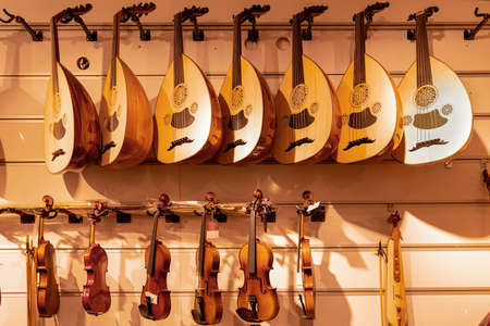 Interior view of Turkish musical instrument with hanging lute and violin. Stock Photo