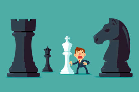 Businessman with white king chess piece get surrounded by black chess pieces. Business plan and strategy concept.