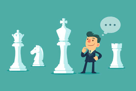 Businessman standing among big chess pieces planning a strategy. Business plan and strategy concept.