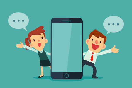 Man and woman talking beside phone with blank screen.