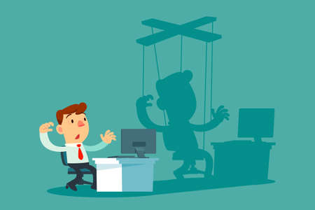 Businessman sitting at office desk and his shadow hanging on strings like puppet. Business manipulation, controlling concept.