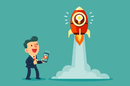Businessman use smart phone to launch his idea rocket. Business creativity and start up concept.