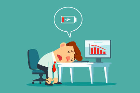 Frustrated and tired businessman laid his head on office desk with low battery icon. Business stress and frustration concept.