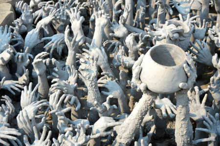 thailand s landmarks: a lot of hands at white temple, Wat Rong Khun in thailand