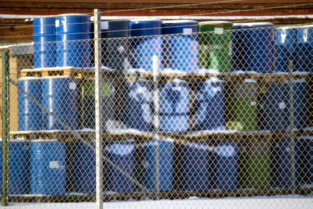 Barrels with containing hazard waste marked with a scull photo